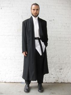 2. Yohji Yamamoto: Made of lustrous wool gabardine, this coat is double breasted and has a scarf-like shawl lapel. Inside, is an adjustable...