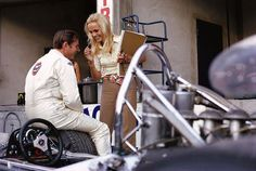 1969, XL Gran Premio d'Italia. Monza. Sally Courage , Piers Courage's wife, chatting animatedly with Bruce McLaren in the pits ... Relax Imagine Alonso's girlfriend doing the same with Vettel sitting on a Redbull ?  Photo Rainer W. Schlegelmilch