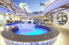 "Disney Cruise Line's sparkling-blue Quiet Cove Pool, an adults-only pool on the Disney Dream, features an elegant ""watering hole"" with cocktails and beverages so adults can unwind in a calming environment"