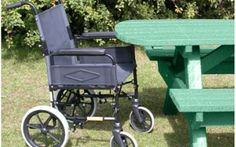 Our esxtende top picnic table in green which allows wheelchair access to the table.