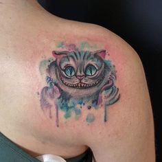Tattoo by Michela Bottin. #cheshirecat #aliceinwonderland #watercolor