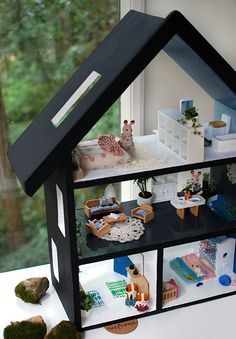 How to paint a doll house and furnish it with repurposed objects, miniature live plants, and handmade decor.