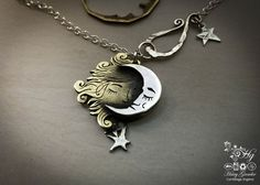 Handcrafted and recycled sterling silver shillings turned into a Sun and the Moon and the Stars necklace.