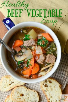 Healthy Beef Vegetable Soup is loaded with mushrooms, kale, carrots, chewy farro and tender chunks of beef!  Recipe at Garlic + Zest!