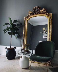 Black walls, giant gilded mirror