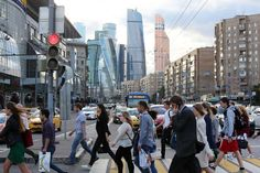 Pedestrians near the Moscow International Business Center. A Moscow startup is preparing to sell a facial recognition package that correctly identified 73% people in a one million photo database.