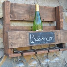 Customize a wall hanging reclaimed pallet wine rack with a rustic chalkboard.