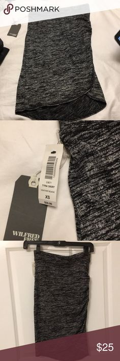 Wilfred Free Tyra Skirt- New with tags! This skirt is a heather black color. It has never been worn and is new with tags. It is made with Wilfred Free's signature fabric, Reposa- a luxe jersey that skims the body. It has a hint of stretch to make the skirt flattering. Aritzia Skirts Midi
