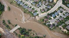 A residential neighborhood and connecting road in Lyons, Colo., are cut in two by flood waters as flooding continues to devastate the Front ...