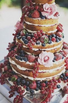 Red white and blue berry naked cake dusted with powder sugar.