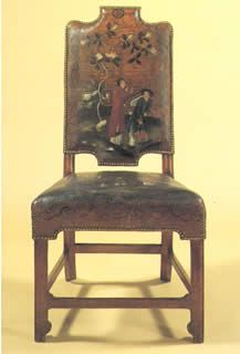 English chair c1705 –10 Beech and walnut, upholstered in gilt and painted leather, close-nailed, 101.5 x 51.8 x 56.3cm