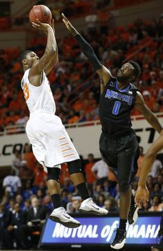 Oklahoma State's Marcus Smart shoots over Damien Wilson during a basketball game against Memphis on Tuesday, November 19, 2013. MATT BARNARD/Tulsa World
