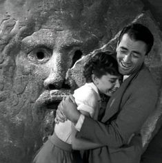 Audrey and Gregory Peck at the mouth of truth, from Roman Holiday.