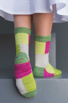Designer Mone Dräger came up with a fun, distinctive way to use sets of mini-skeins (like SweetGeorgia Yarns Party of Five) that shows off each yarn to its full advantage: the Cube Socks. This sock knitting pattern features intarsia in the round, a clever method that creates smooth joins on each side, making fun, color-blocked socks without any seams.