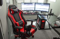 Amazing Battle station Gaming Computer Desk setup Black Glass L Shaped Desk dual Monitors with red Gaming Chair