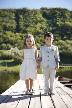 This adorable flower girl and ring bearer would be turning heads at any #wedding.