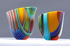 Ruth Shelley - The Sisial Collection is based on a development of assembling glass in various length strips and arranging them on edge to form various shapes which gives great freedom in design, colour and form. It is then carefully fused, shaped and coldworked. The 'Sisial' collection concentrate mainly on the Colours that adhere Wales together in a 'Wales Adhesion' Range (Gludiad Cymru) {phonetic - Glydiad Kymry}