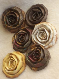 fold a strip of 2 inches hand torn and distressed design paper and then twist into a flower. simple and easy still elegant.