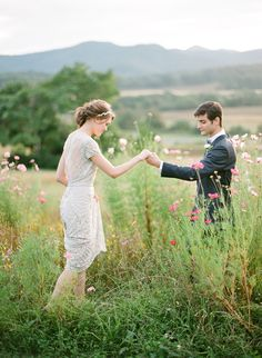 This wedding dress is simple yet elegant. Love that there is a pretty spring meadow near this elegant outdoor wedding location. Perfect for a homespun wedding!