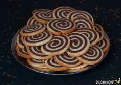 Les biscuits spirale, ça me titillait d'essayer car je trouve ça vraiment trop beau. Ni une, ni deux j'ai ressorti ma recette parfaite de sablés de ma grand-mère (n'essayez pas de m'en faire changer elle me sert de base pour tous mes biscuits) et je l'ai adaptée à la technique des sablés spirale. Une pâte …