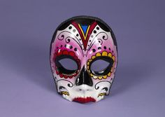 Celebrate Dia de Muertos with this female Day of the Dead Mask! This beautiful Day of the Mask is designed with feminine features and flowery eyes! This can also be worn for a Halloween costume! Additional Day of the Dead masks, costumes and other accessories are available and sold separately.