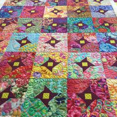"""""""Finished this one this morning, there are 120 different #kaffefassett fabrics in the blocks. I made this one in 2014 and it was before I started quilting,…"""""""