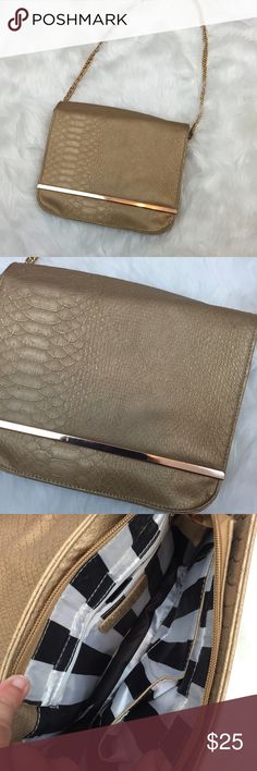 🍀CHARMING CHARLIE Gold Chain Sparkle Purse Get this classy, gold sparkle, scale purse.  This is perfect for a special occasion or even a night on the town.  This bag features flap closure and is printed with scale detailing.  This also has a gold chain strap.  This has been used a few times.  This has minimal wear.  Most wear inside such as makeup marks.  It is in great condition!  Get this now! Charming Charlie Bags