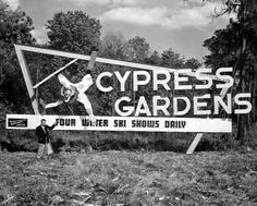 Four water ski shows daily at Cypress Gardens. Early sign. Probaby Dick Pope in the picture.