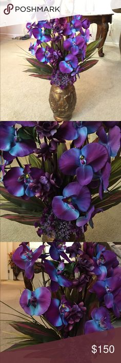 elegant blue and purple orchid arrangement. I made this hand made. Extremely elegant and stunning. It's tall. About 4 1/2 feet tall. The vase is Italian made handmade  Other