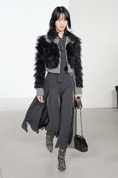 The complete Michael Kors Collection Fall 2018 Ready-to-Wear fashion show now on Vogue Runway.