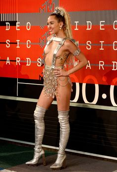 Putting on a show: The 22-year-old singer turned heads at her hosting gig with a very revealing silver number