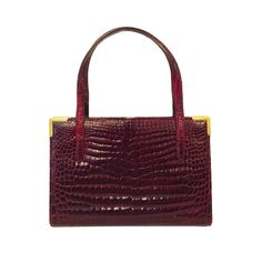 Vintage Gucci Merlot Crocodile Structured Hand Bag  | From a collection of rare vintage top handle bags at https://www.1stdibs.com/fashion/handbags-purses-bags/top-handle-bags/