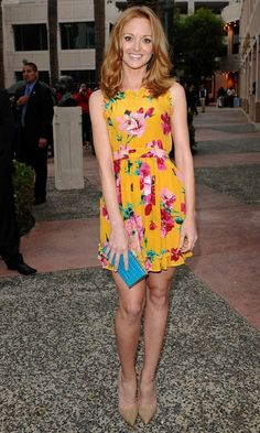 Jayma Mays of Glee mixes a bright floral print with nude pumps.