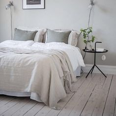 If you are a simplistic you will love this danish master bedroom design in Gothenburg with gray walls and light hardwood floors.    Double tab for more images.  #fortheloveoflinen #linen #bedlinen #tellmemore #interior4all #linenbedding #pureline #purelinenutrition #interiordecor #bedroomdecor #bedroominspiration #handmade #handmadebedding  #tailoredmade #instadaily #hardwoodfloor #simplistic