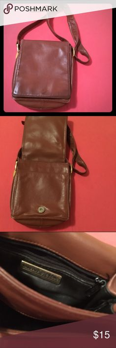 Leather Brown Crossbody Bag Purse Adjustable length strap. 8' long 7' wide. 2 front compartments and 2 back. Zipper inside. Valerie Stevens Bags Crossbody Bags