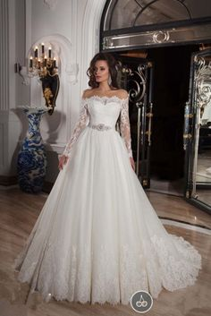 Elegant Off-the-shoulder Long Sleeve Lace Wedding Dress With Beadings