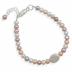 Peach Pink and White Pearl Bracelet Sterling Silver Natural Color Pearls - Made in the USA AzureBella Jewelry. $28.85. Natural color cultured freshwater pearls. Jewelry gift box included. Matching necklace and earrings available