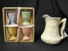 Two Lovely Home Décor items. Includes a box of Four Easter Embossed Egg/Candle Holders. Pretty Pastel colors. Plus a Gorgeous Leaf embossed white pitcher with original tag. Marked to the bottom: I. Godinger Co. Nice skulpted handle.