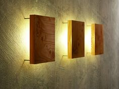 Modern wall lamp made of wood by uniic- Moderne Wandleuchte aus Holz von uniic Simple and modern wall light with backlit solid wood top.