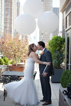 Love the idea of these giant balloons for photos, perhaps to match the wedding colours?
