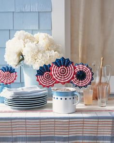 Patriotic Fans  Wave away the summer heat with these handheld paper fans. They also make great party favors.