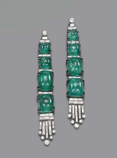 A PAIR OF EMERALD AND DIAMOND EAR PENDANTS  Each designed as four graduated cabochon emeralds with baguette-cut diamond detail and tassel fringe to the diamond collet surmount, circa 1935,