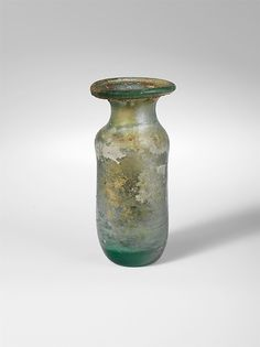Glass bottle Period: Early to Mid Imperial Date: 1st–2nd century A.D. Culture: Roman Medium: Glass; blown Dimensions: H. 3 in. (7.6 cm) Classification: Glass Credit Line: Gift of Henry G. Marquand, 1881