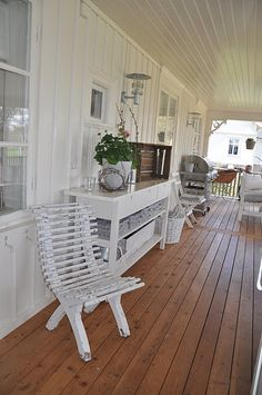 White veranda, with wooden floors. Not too narrow please.