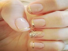 Nude Nails with Gold Stripes and Single Glitter Nails