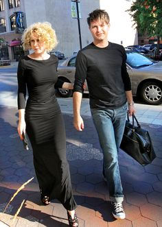 Indianapolis Symphony Orchestra music director, Krzysztof Urbanski and wife, Joanna, walking to the musician's entrance at the Hilbert Circle Theatre for the opening weekend featured concert. (Photo/Espich)