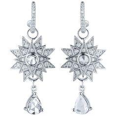 Jade Jagger Star Burst Diamond Earrings | From a unique collection of vintage dangle earrings at https://www.1stdibs.com/jewelry/earrings/dangle-earrings/