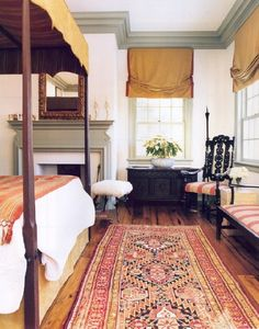 a great traditional mix of dark wood furniture, painted trim, warm faded colors and textiles