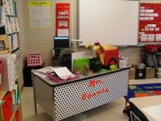 use wrapping paper to decorate an ugly metal desk....cute! Plus common core wall by mekamatt