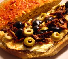 libyan food: Egg Omelette Sandwich, with Cheese, Sundried Tomatoes, Harissa and Olives